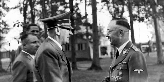 Hitler greets Heinrich Himmler, the national leader of the SS.