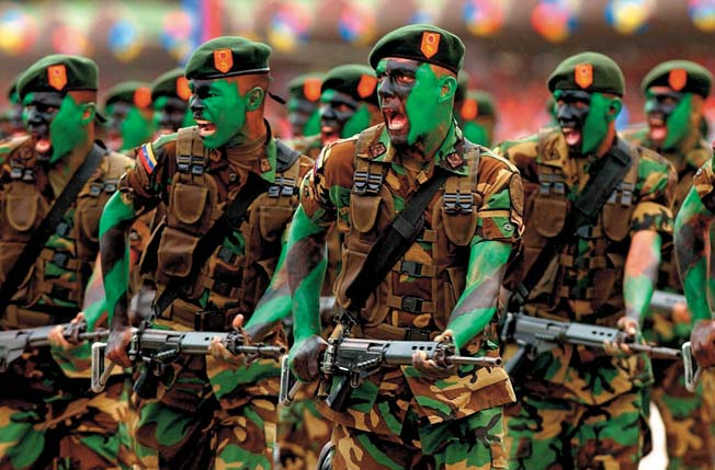 Here, camouflaged Venezuelan paratroopers participate in an Independence Day parade in Caracas, July 6, 2005.