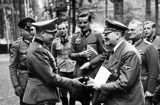 General Hermann Balck, a senior German commander during the execution of Case Yellow, the invasion of France and the Low Countries, receives congratulations from Hitler on the stunning victory.