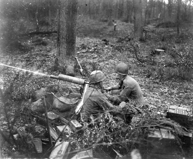 American soldiers man a .30-caliber machine gun. The fighting took its toll on U.S. forces, requiring units to be pulled out of line to refit and fresh units inserted into the battle in their place.