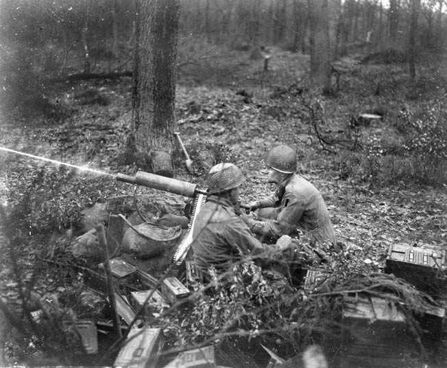 two soldiers of the U.S. 39th Infantry Regiment fire a .30-caliber machine gun .
