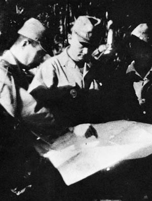 Lieutenant General Tadamichi Kuribayashi (center), commander of the Iwo Jima garrison, looks over a plan of the island's underground defenses. He did not survive the battle.