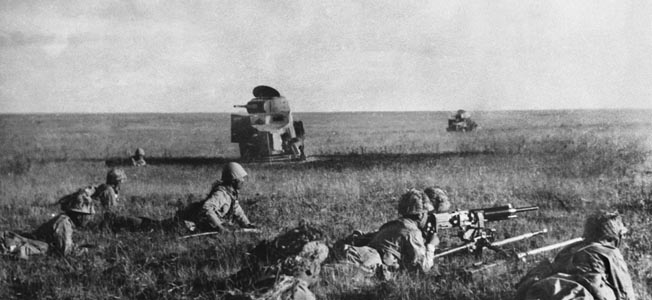 Japanese light armor and infantry advance in an attack near Nomonhan that initially caught Soviet and Mongolian forces by surprise.