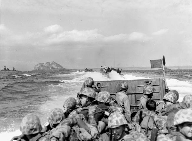 LCVPs approach Iwo Jima. Mount Suribachi is visible at the left of the horizon line.