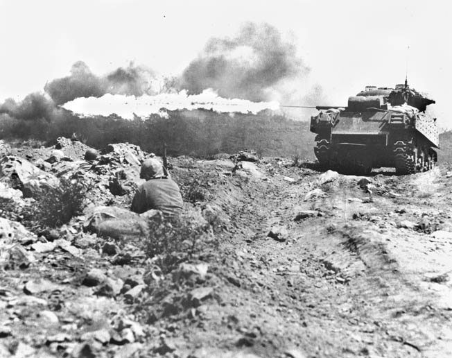 Since very few Japanese willingly surrendered, the Marines had to resort to flamethrowing tanks and backpack flamethrowers to end enemy resistance.