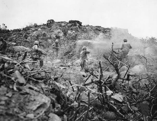 Marines silence an enemy-held cave with grenades and BARs.