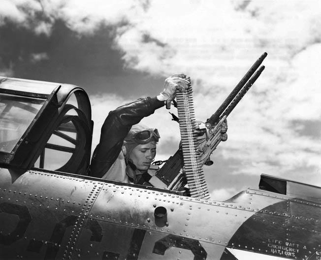An SBD Dauntless tailgunner loads ammunition for his twin ANM2 .30-caliber machine guns. The Stinger fed M2 .30-caliber cartridges from metallic disintegrating links.