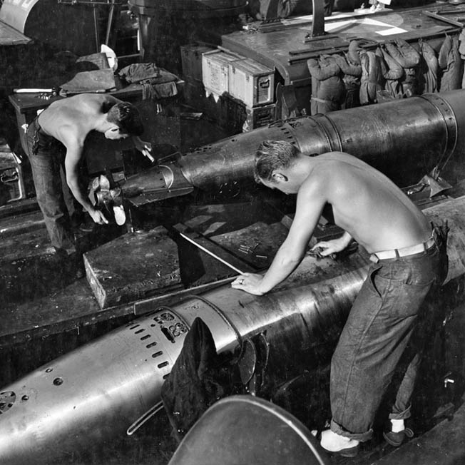 PT boat crewmen ready torpedoes for firing. Early in World War II, the U.S. Navy experienced great frustration with torpedoes that often malfunctioned.