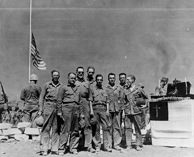 Fourth Marine Division chaplains on Iwo Jima following services at 4th Marine Division Cemetery (left to right): George C. Strum, Howard V. Sartell, Sneary (first name unknown), Roger W. Barney, E. Gage Hotaling, John H. Craven, Wilson H. Singer, Harry C. Wood.