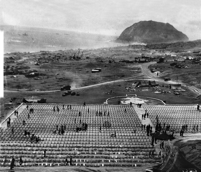 Aerial view of the 3rd and 4th Marine Division cemetery on Iwo Jima, with Mt. Suribachi in the background. Another cemetery on Iwo Jima, for the 5th Marine Division, held over 2,200 graves. Nearly 7,000 U.S. Marines died in over a month of furious fighting.