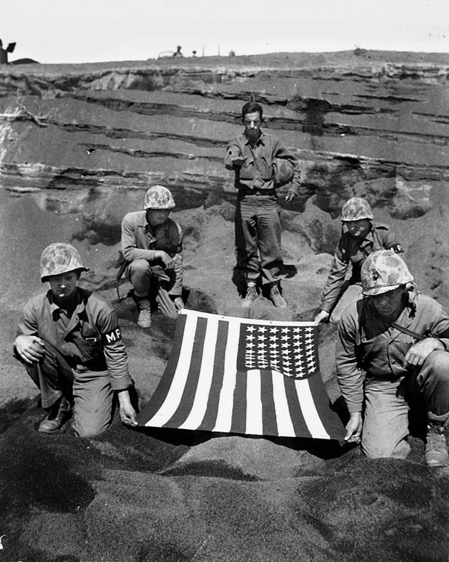"""You have gallantly given your life on foreign soil in order that others might live. Now we commit your body to the ground,"" said Chaplain Hotaling, photographed at a committal service for a fallen Marine on Iwo Jima."