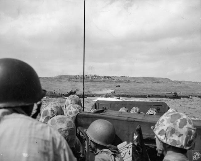 U.S. Marines keep low aboard their landing craft as they approach the beaches of Iwo Jima.