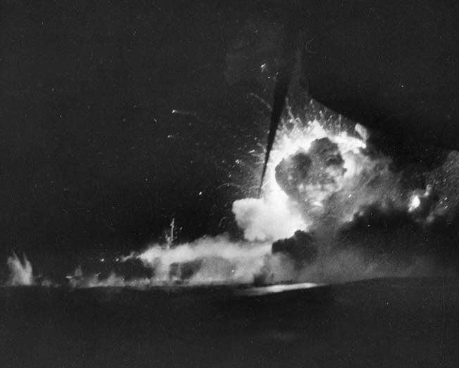 A catastrophic explosion wracks the escort carrier Bismarck Sea off Iwo Jima. On February 21, 1945, a pair of Japanese kamikaze suicide aircraft crashed into the carrier, which later sank with the loss of 318 American naval personnel.