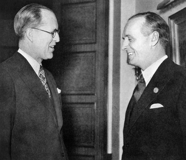 Ambassador Kennedy said that, in case of war between Britain and Germany, the U.S. might remain neutral—words that angered Britain. Here he meets with German Foreign Minister Joachim von Ribbentrop at a London reception in 1938.