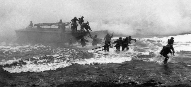 """Fighting Jack"" Churchill leads his unit, sword in hand, through the pounding surf during a training exercise October 1941."