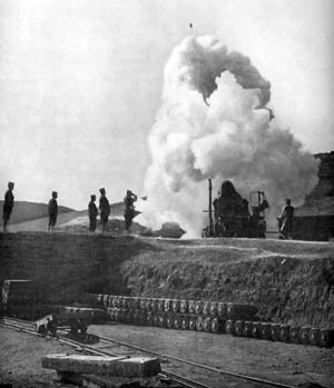 "A 500-pound shell from a Japanese 11-inch siege howitzer can be seen at the top of the photo. The howitzers, nicknamed ""Osaka babies,"" could hurl shells some 5½ miles."