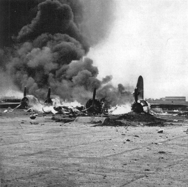 A Boeing B-17 Flying Fortress heavy bomber of the ABDA air forces is consumed by flames in the aftermath of a Japanese air raid on installations at Bandoeng on the island of Java on February 19, 1942. The raid was in preparation for the Japanese invasion of the island, and soon the attackers were in control of the skies.