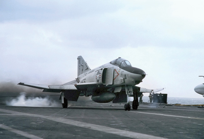 An American RF-4B Phantom II jet lands on the aircraft carrier USS Midway during FLEETEX 83 exercises.
