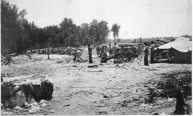 A shirt-sleeved crew mans Battery A, 1st U.S. Artillery, during the siege of Port Hudson.