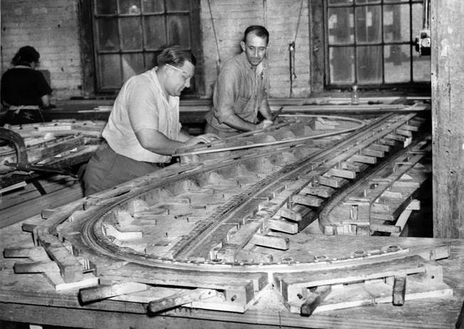 At the Pratt, Read Soaring Company in September 1943, workers at the company's Deep River, Connecticut, facility fashion the lamination jig for a glider's nose during a construction.