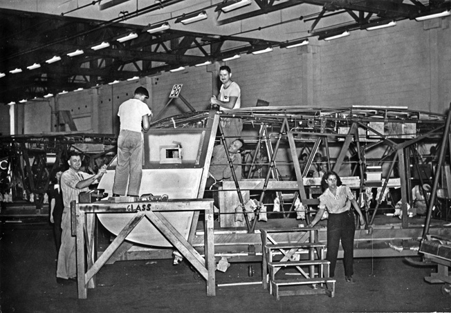 Pratt, Read employees perform primary assembly work on a Waco CG-4A glider. With over 70,000 parts, the CG-4A proved almost impossible for manufacturers with little or no aircraft-making experience to build.