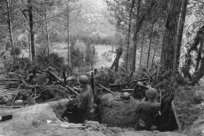 American soldiers inspect a hastily abandoned German machine-gun nest in the Hürtgen Forest. The fighting in the Hürtgen, which began in the autumn of 1944, proved to be some of the toughest in the European Theater.