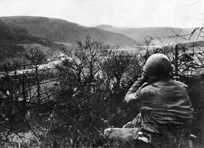 WWII: GERMANY, 1944. A U.S. soldier at a lookout post above the Rur in Eifel, Germany. Photograph, 1944.