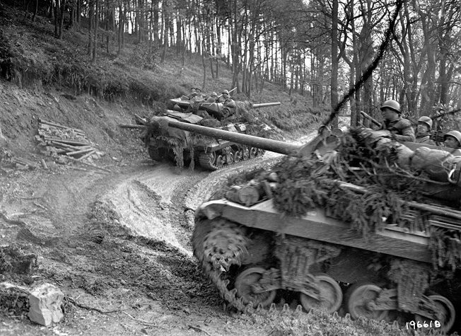 American armored vehicles make their way up a slippery incline in the Hürtgen Forest. The men of the 2nd Ranger Battalion relieved elements of the 5th Armored Division when they arrived at Hill 400.