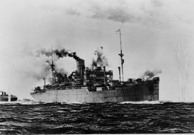 After conversion to an armed merchant cruiser, HMS Jervis Bay was escorting Convoy HGX84 on November 5, 1940, when the German pocket battleship Admiral Scheer came into view. The captain of Jervis Bay did his duty and defended the convoy to the last.