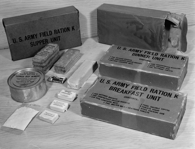 U.S. Army K Rations supplied soldiers in the field with a high-calorie, lightweight  meal when more substantial field kitchen or food preparation facilities were unavailable. The K Ration weighed 32.86 ounces with three meals packed into separate boxes. It contained 3,726 calories.