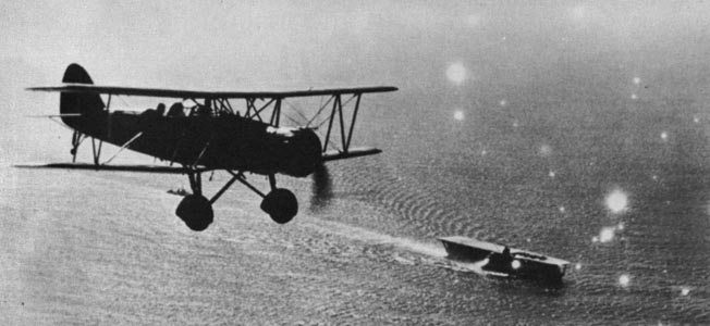 A Type 96 carrier-based attack plane of the Imperial Japanese Navy flies above the aircraft carrier Kaga in 1937. Along with Aichi dive bombers, Type 96 aircraft flying from Kaga took part in the attack on Panay.