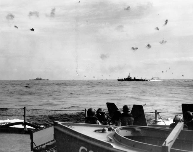 In this photo taken from the deck of the battleship USS Alabama, U.S. Navy destroyers and other vessels engage Japanese Kamikaze planes intent on crashing into them. This photo was taken on May 14, 1945, off the coast of Okinawa, three days after the destroyer USS Hadley was hit by three Kamikazes and a 550-pound bomb at Radar Picket Station 15.