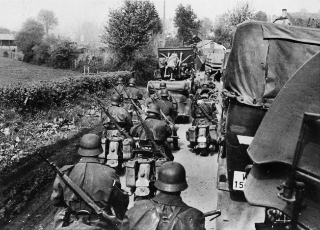 Motorized German troops and vehicles pour into Belgium May 11, 1940. Striking fast and hard was a Knobelsdorff trademark.