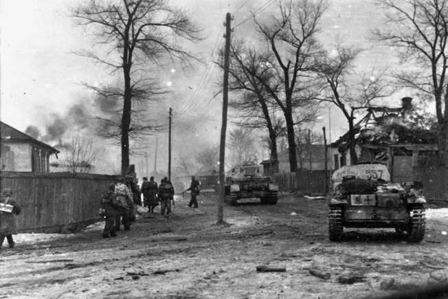 German troops enter a burning suburb of Kharkov, March 1943. Knobelsdorff's XLVIII Panzer Corps was instrumental in the German victory here.