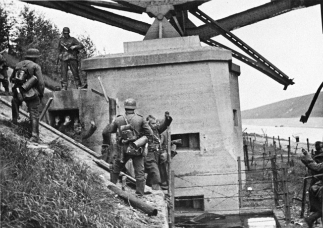 Thanks to Knobelsdorff's aggressiveness, German troops of his 19th Infantry Division capture a bunker built into the end of a bridge that spanned the Albert Canal, May 1940.