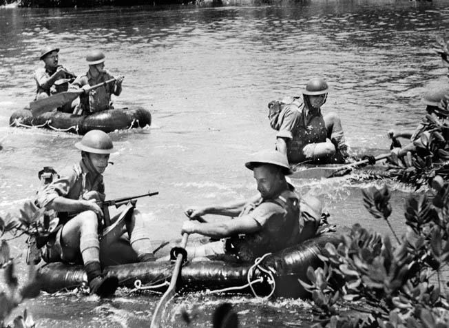 Six Australian soldiers with tommy guns cross a jungle river in rubber rafts during training. The Aussies worried that if Malaya fell, Australia probably would be invaded next.