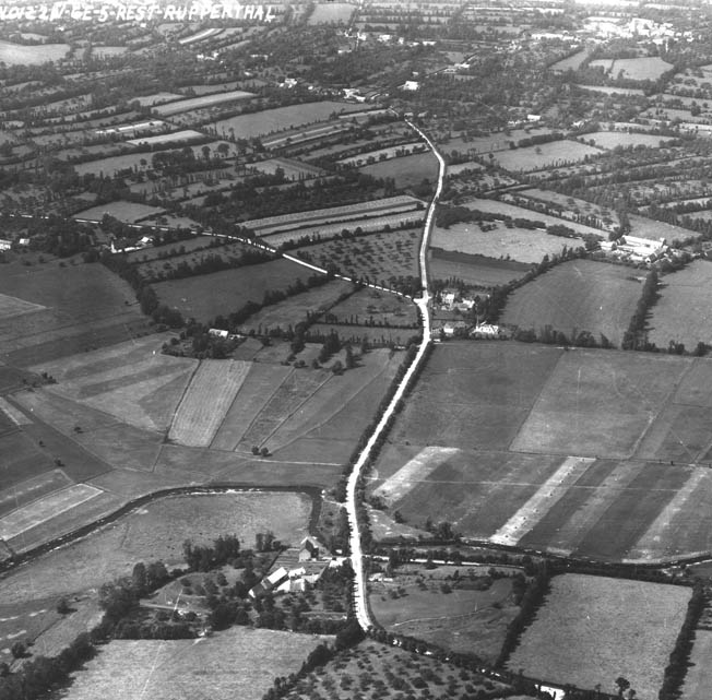 Looking west from Sainte-Mère-Eglise, the La Fière Bridge stands at the bottom of this photo, to the right of the embattled La Fière Manor. The large field in the center of the photo was completely submerged during the month of June 1944.
