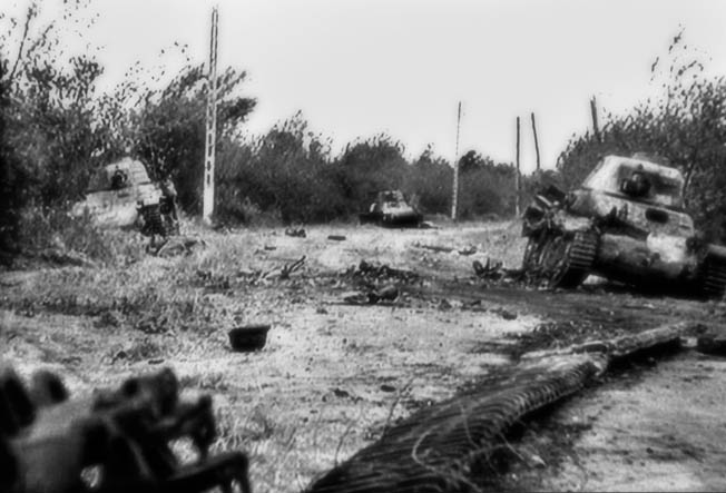 These tanks of German Panzer Ersatz und Ausbildungs Abteilung 100 (100th Tank Replacement and Training Battalion) were knocked out during the intense fighting that unfolded around the La Fière causeway. All three of the vehicles seen here are French-made tanks that were captured by the Germans in 1940. This image was taken from a reel of motion picture footage filmed by a Signal Corps photographer on June 10, 1944.