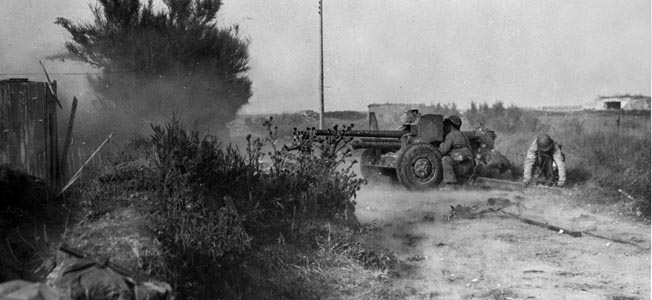 An American 57mm antitank weapon fires at German armor and troop concentrations in Normandy. During the early phase of the fighting at the La Fière causeway, the 57mm gun was the heaviest available to the men of the 82nd Airborne Division.