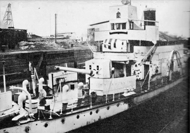 The British gunboat HMS Ladybird lies in drydock at Shanghai undergoing repairs after being attacked and seriously damaged by Japanese aircraft. One British sailor was killed and several others were wounded during the unprovoked attack.