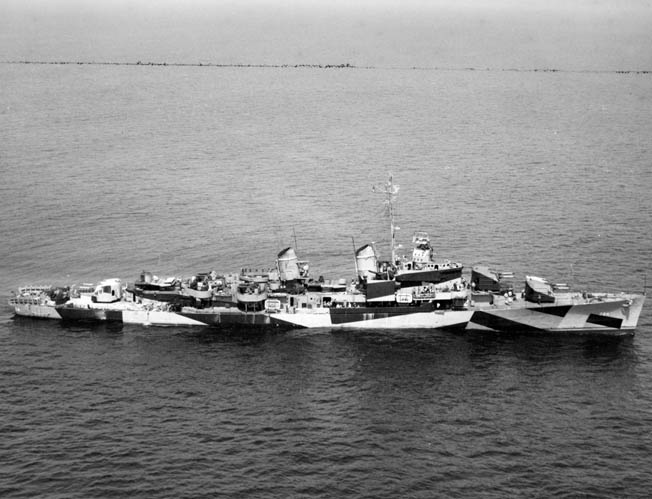 "The Laffey in her coat of ""dazzle camouflage,"" shown in August 1944, after supporting the Normandy invasion. First used in World War I, the garish paint schemes worn by many warships partly disguised a ship's identity, size, speed, and heading."