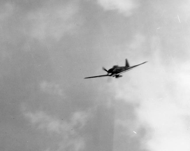 "A bomb-laden Mitsubishi A6M5 Reisen (""Zero"" or ""Zeke"") homes in on its target. The Japanese reliance on kamikaze attacks intensified during the Battle of Okinawa."