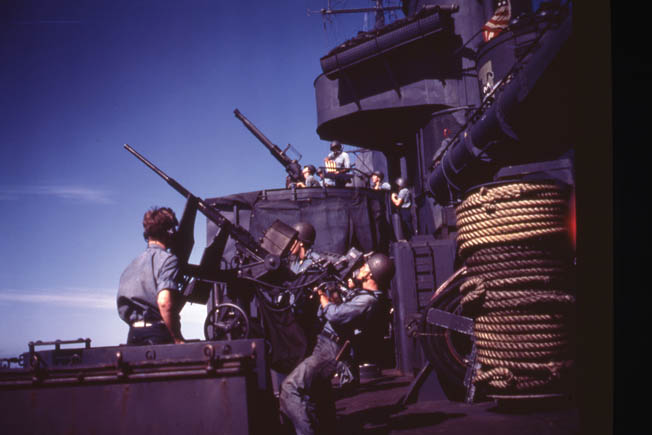 Destroyers bristled with guns for self-protection. This view shows a 20mm gun (foreground) and a Bofors 40mm gun behind it.
