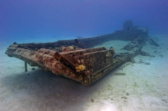 A sunken Japanese Daihatsu landing craft lies in a ghostly shroud off the coast of Saipan. The landing craft was probably used to move men and equipment between Saipan and the neighboring islands of Guam and Tinian in the Marianas during the war.