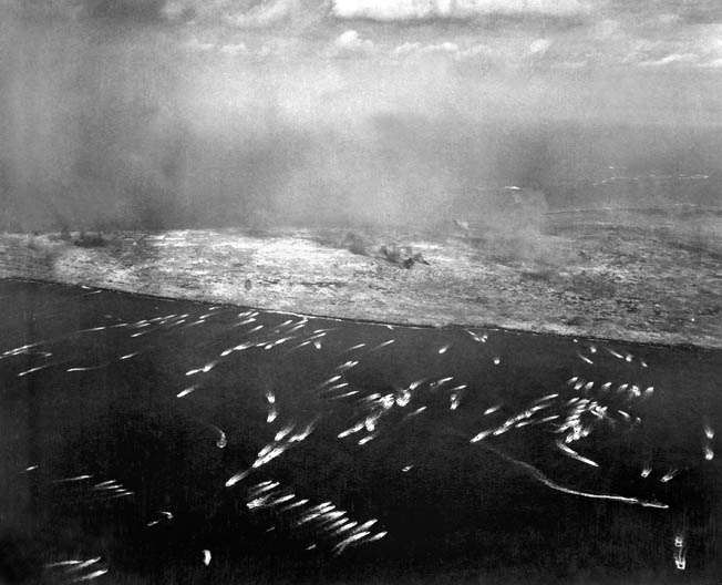 H-hour at Iwo Jima: White wakes show landing craft bringing the first wave of Marine invaders.