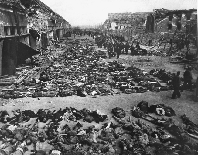The bodies of hundreds of slave laborers are laid out at Nordhausen concentration camp in preparation for burial. GIs from the 3rd Armored Division liberated the camp on April 11, 1945.