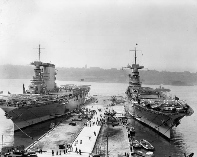 The aircraft carriers Lexington and Saratoga lie moored in New York harbor in 1934. The two large carriers were completed on battlecruiser hulls, and both served with distinction during World War II.