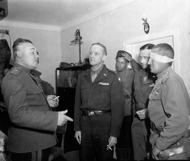 Maj. Gen. Stanley E. Reinhart (center), commander of the 65th Division, meets with his Russian counterpart, commander of the 7th Guards Parachute Division, after their units linked up at Erlauf, Austria, and they learned of Germany's surrender. Tulper recalls drinking vodka and scotch with Russian soldiers in Leonfelden.