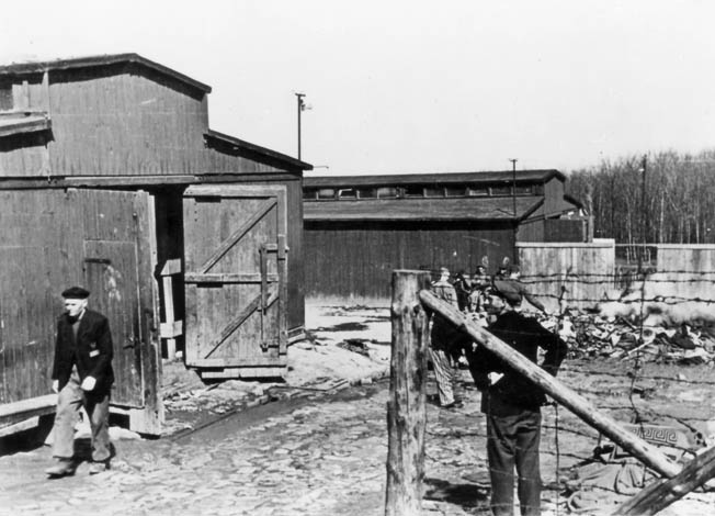 "Pre-fabricated horse stables served as barracks in the quarantine area of Buchenwald known as the ""Little Camp."" As many as 2,000 prisoners were crammed into one building, and sanitation facilities were practially non-existent."