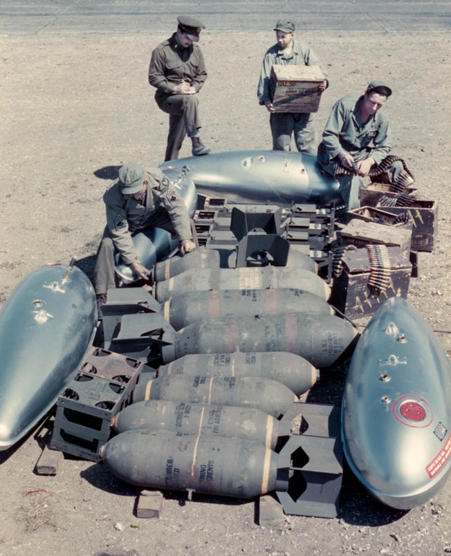 Ground crewmen at an Allied airfield await orders to begin arming a North American P-15 Mustang fighter for its next mission deep into Germany. The drop tanks, ammunition, and bombs may indicate that the Mustang will embark on a fighter-bomber sortie in support of Allied ground troops.